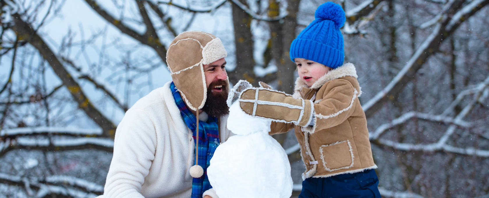 Dad and son making a snowman