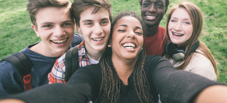 Teens taking a group selfie